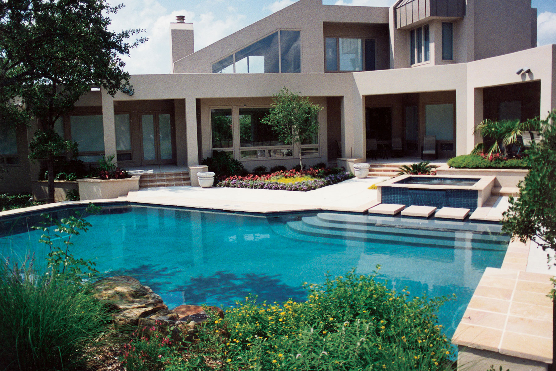 How much does a custom pool cost keith zars pools for Cost to build a house in texas